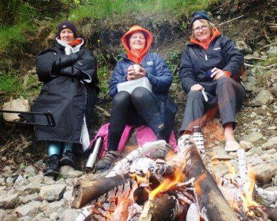 Swimmers around campfire