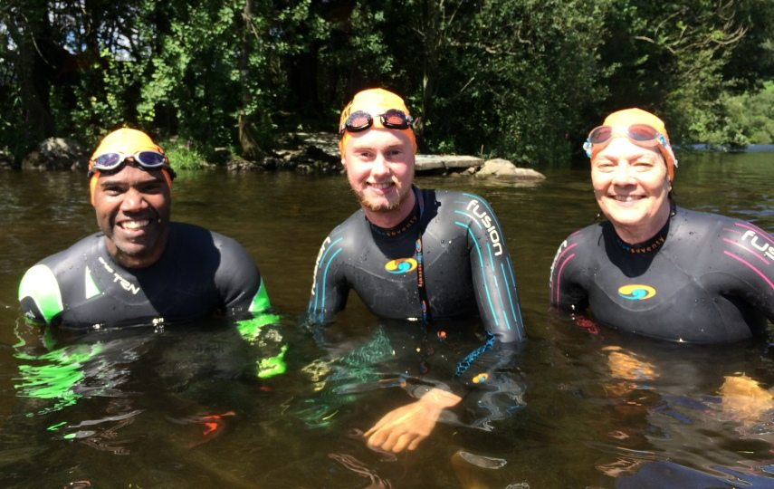 in the water at an introduction to open water swimming course