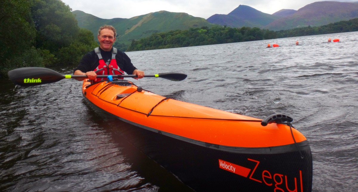 pete in Kayak guiding swimmers