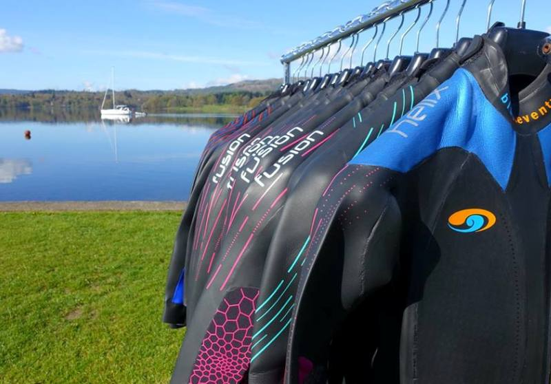 row of wetsuits windermere