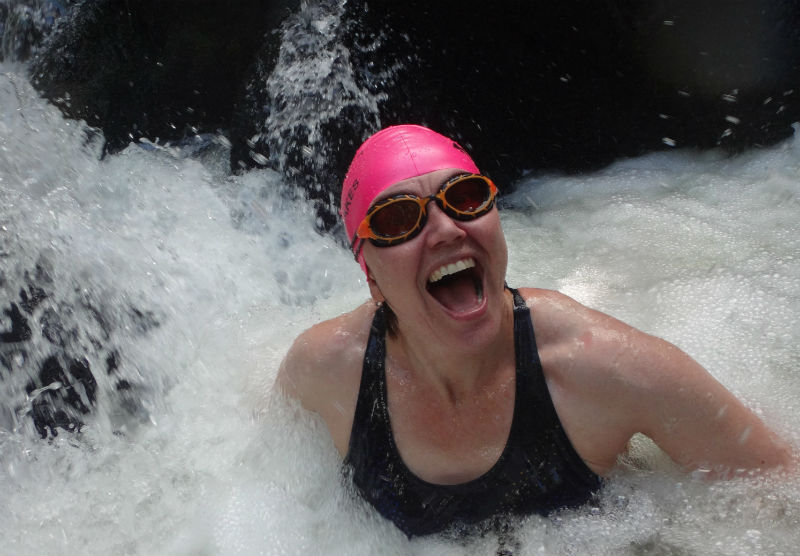 Where to Swim in the Lake District: Swimmers enjoying a foaming river dub