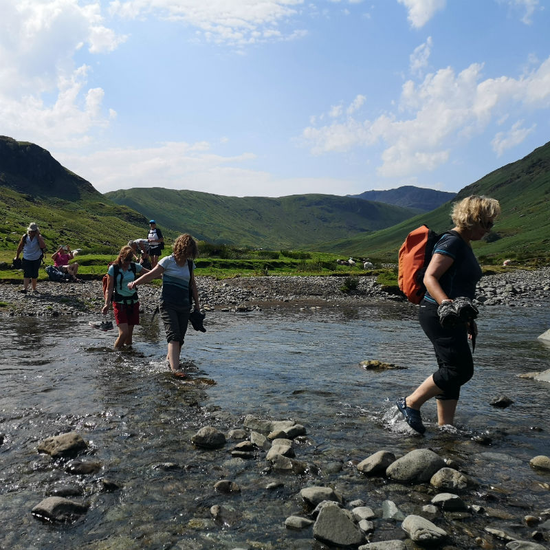 wading across river