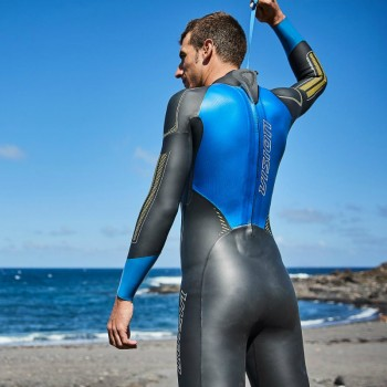 man on beach in zone3 vision wetsuit
