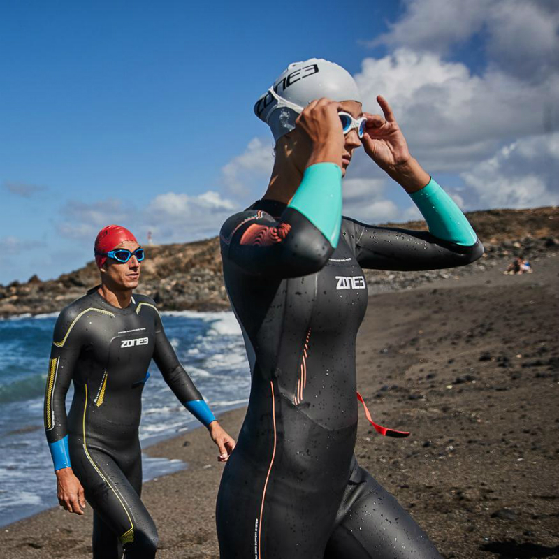 men and lady in Zone3 Vision wetsuits