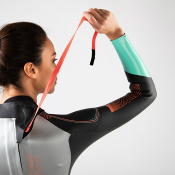 woman zips up Zone3 Vision wetsuit