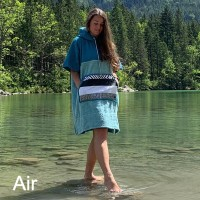 Lady paddling in Lake wearing Air change robe