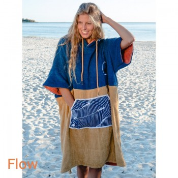 Lady on beach wearing Flow Bamboo Change robe Towel
