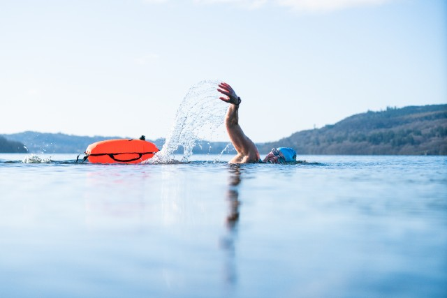 lady swimming with eco tow float